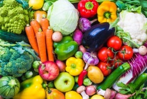 Vegetables and fruits background. NutriShield Multi Vitamins and Minerals