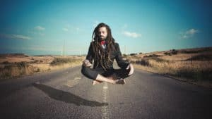 Stylish elegant dreadlocks businessman levitating NutriShield Multi Vitamins and Minerals